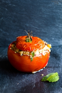 Stuffed tomatoes with couscous, chickpea, olives and tahini sauce