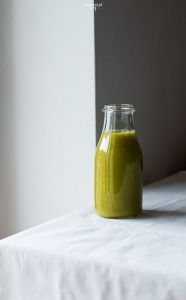 Green barley grass smoothie with mango
